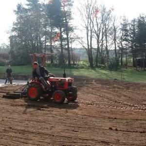 Grading lawn prior to sowing with grass seed