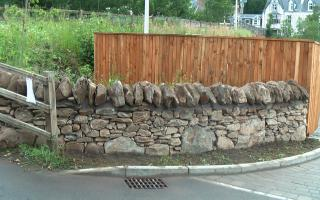 Stone wall and timber fence