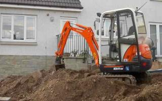 Digger and rear of house