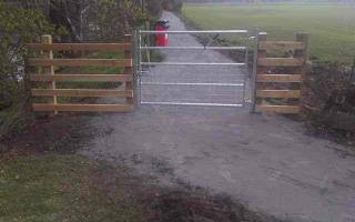 Metal gate and timber rails