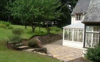 New whinstone wall with paving