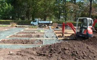 Redevelopment of garden with gravel paths and timber edge