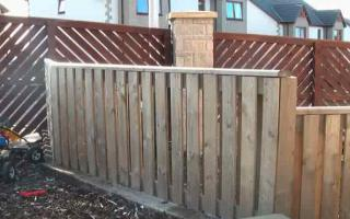 Short timber board fence