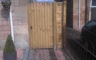 Solid high timber gate