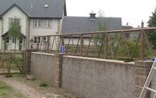 Trellis fence under construction