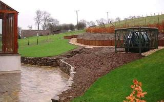 Walling and turfing after completion