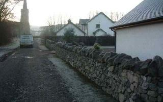 Whinstone wall with stone copes