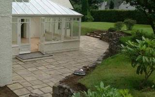 Whinstone walling and mellow cotswold paving buff
